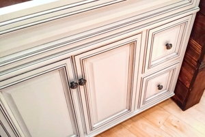 vanities — two stone cabinets and decor