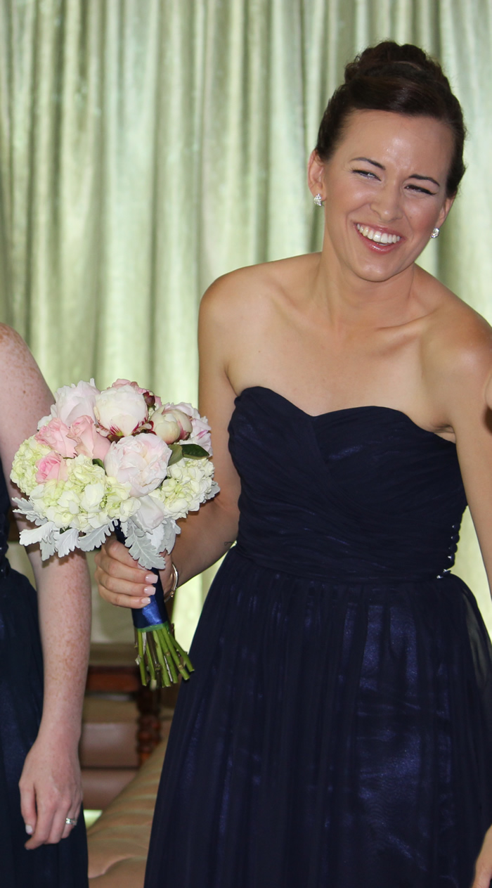 navy blue silk bridesmaid dress with bouquet of hydrangeas peonies and old roses