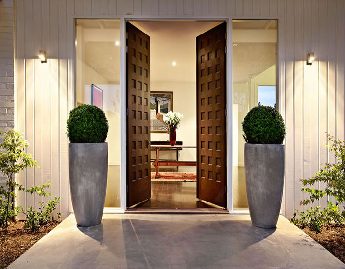 A beautiful entrance white painted timber house by the for Beautiful front door entrances