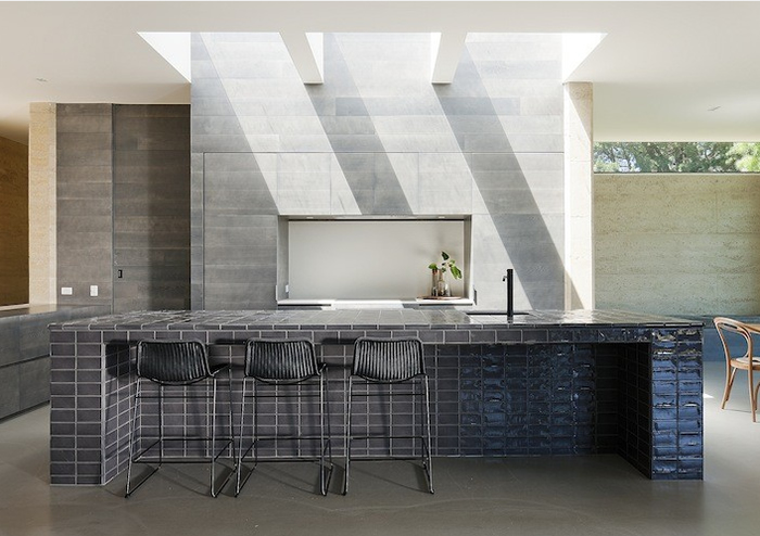 merricks house by robson rak architects tiled kitchen island bench