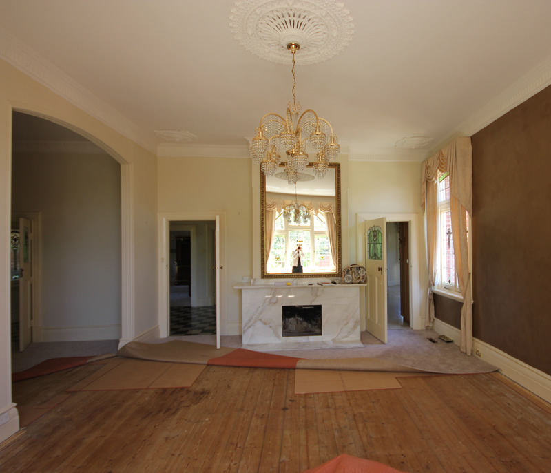 Before : heavy drapes, weird ceiling roses in the corners of the room and the patched baltic pine flooring...all has now gone...as has that very low travertine mantlepiece and mirror which was out of proportion.