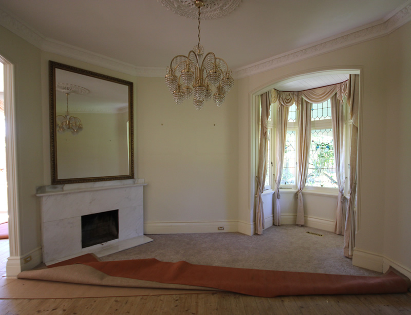 Before : the formal drawing room. Mirror, mantle and travertine surround, light fitting & drapes have all been removed.