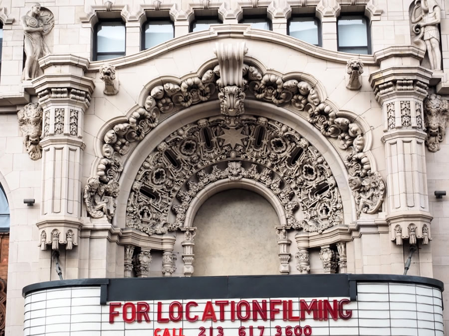 The Million Dollar Theatre (1918) is built in a Spanish Baroque style, and includes elaborately carved symbols of the Wild West, such as bison heads and longhorn skulls.