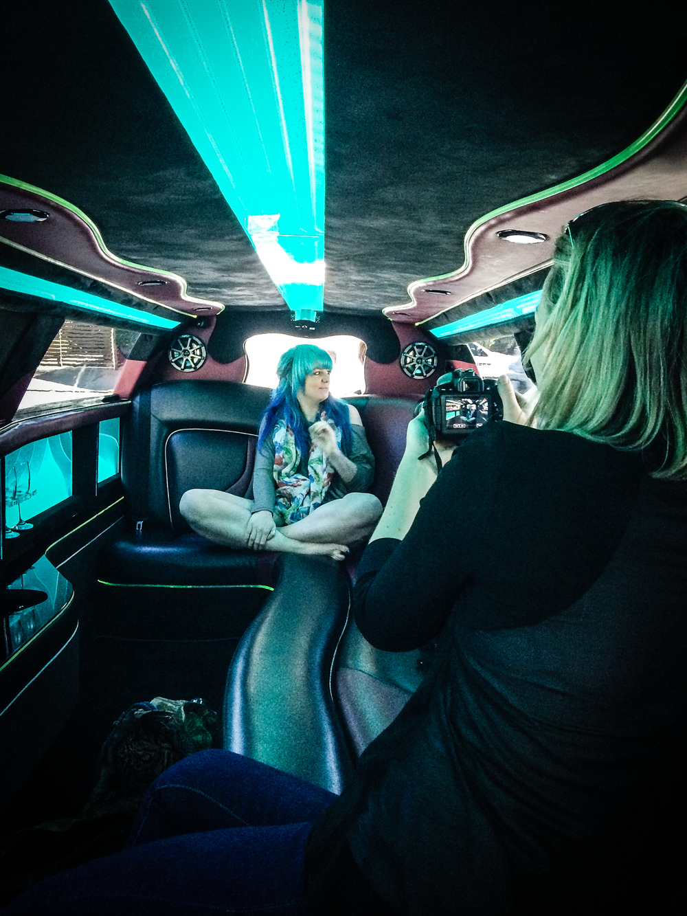 Jaymee Tully being interviewed by Jasmine Gailer during her limousine ride to the studio.