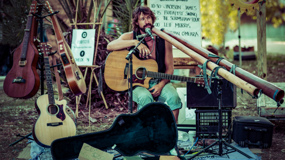 Byron Bay roots/folk artist,  Tristan O'Meara , has performed for thousands on the streets of cities across the world from Australia to the UK, Ireland, Europe, India, Nepal & Bangkok. He spends his life busking around the globe and crafting didgeridoos at his home in the hinterland of Byron Bay.  Tristan rarely performs shows in Australia these days and is re-appearing at Buskers By The Creek as it's one of his favourite world wide festivals.