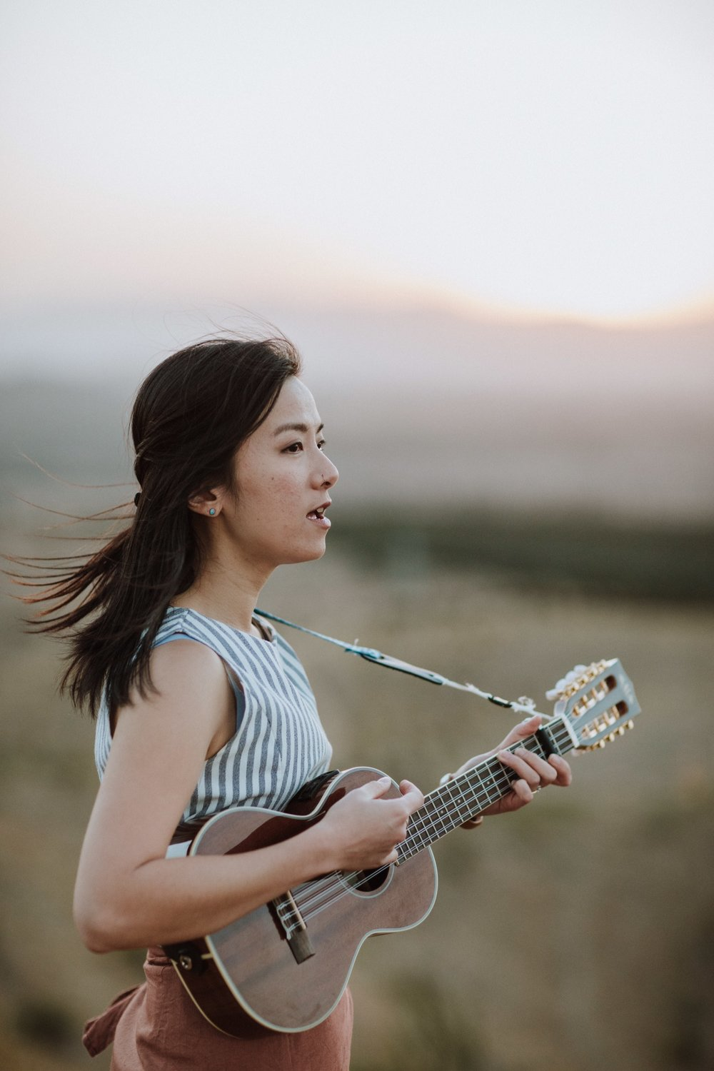 KIM YANG (ACT)  Kim Yang is an acoustic songstress and songwriter with a soothing ethereal voice that captures the attention of passers-by. She started her Australian music journey in early 2016 with a ukulele and a guitar in the streets and cafes of Canberra. Kim's original songs mix elements of folk, pop, blues and jazz and speak candidly from her lived experiences as a partner, daughter, sister, friend and an insecure soul.