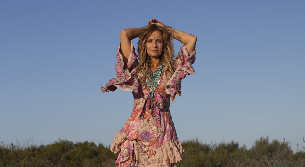 Kasey Chambers   A genre-defying singer and songwriter whose music encompasses the quietude of folk, the honesty of country, the edgy emotions of the blues, and the fearless spirit of rock & roll, Kasey Chambers has become one of the most popular and acclaimed artists of her generation. Raised surrounded by music, Kasey grew up as part of her family's band, the Dead Ringer Band, and started her solo career thereafter. Five of Kasey's twelve studio albums have reached No. 1 on the ARIA Albums Chart, she has won 14 Aria Awards, and was inducted into the ARIA Hall of Fame. Her autobiography,  A Little Bird Told Me… , was released to critical praise, and her latest album  Campfire  was her most honest and austere acoustic album to date.