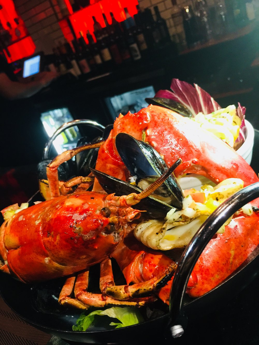 Grilled lobster (1 lb) soft shell , with grilled calamari, sautéed mussles, side spaghetti garlic oil and peperoncino