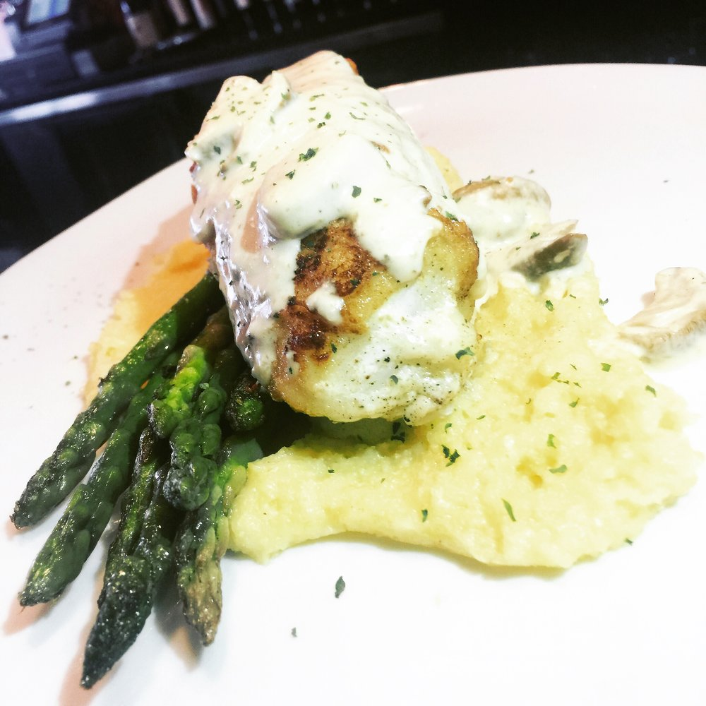 Grilled branzino - with polenta, asparagus in a porcini cream sauce