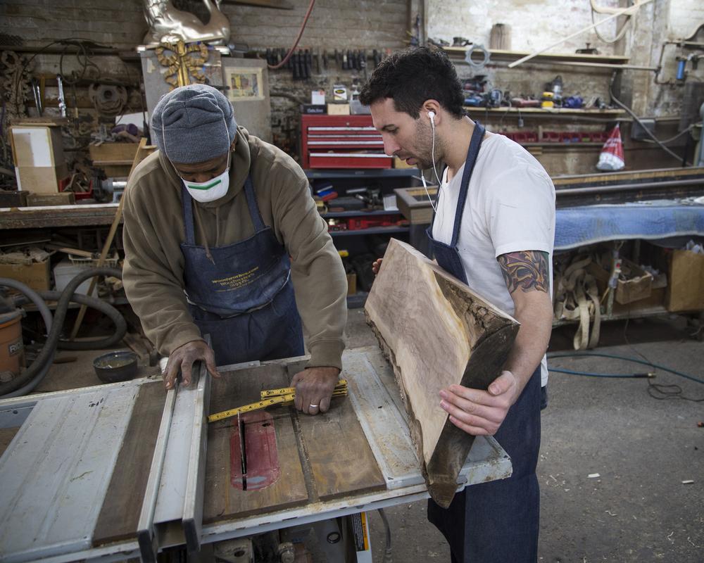 walnut slab being used for a custom built ottoman