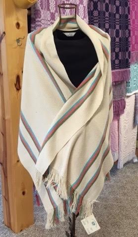 "Sarah Fletcher.  Long, fringed stole; hand-woven of natural raw silk and tencel; cream with colored stripes. More work by this artist at Ben's Old Loom Barn or follow ""Ben's Old Loom Barn"" on Facebook.   FMV   $100      I    GUAR PUR   $125      I    MIN BID$40      I    BID INC$5"