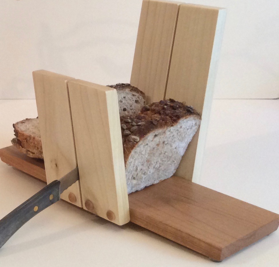 David Courtney.  Bread cutting board/book holder, hand crafted of cherry and poplar; also useful as an iPad holder. More work by this artist at Buxton & Landstreet Gallery.   FMV   $35      I    GUAR PUR   $44      I    MIN BID$15      I    BID INC$3
