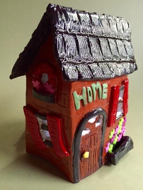 "Nanette Seligman. Clay house lamp, 9"" H x 7"" W x 5"" D FMV  $40 I  GUAR PUR  $50 I  MIN BID$20 I  BID INC$5"