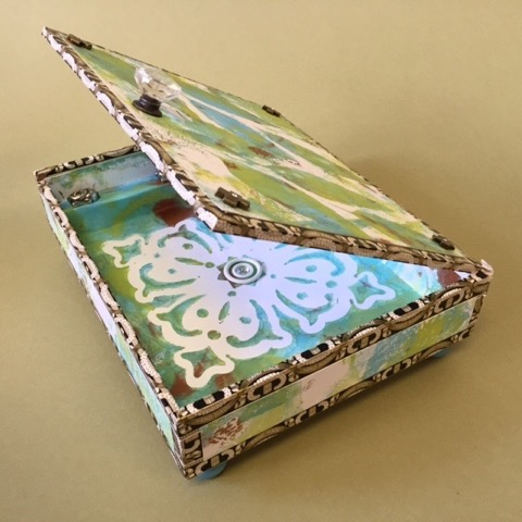 "Kathleen Keller.  ""Blue/Green Leaves,"" keepsake box: cigar box covered with artist's jeweled monoprints,  10""W x 85""D x 3""H. More work by this artist at The Studio Gallery.   FMV   $60      I    GUAR PUR   $75      I    MIN BID$28      I    BID INC$5"