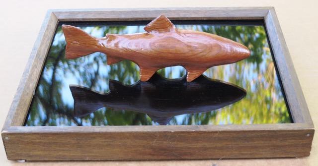 "Ken Dzaack. ""Waiting,"" salvaged redwood, hand-carved 7"" Brook Trout on reflective base. FMV  $50  I  GUAR PUR  $63  I  MIN BID$24  I  BID INC$5"