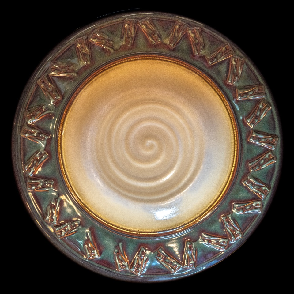 Ceramic Bowl by Pam Snyder Auction Item #141    Dark cream and green, Incised rim,