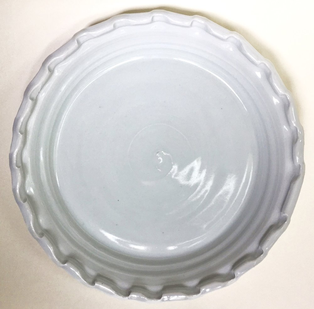"Pie Plate by Malcom Davis Auction Item #178     Hand-thrown/shaped porcelain, 10"" diameter, 1.75"" depth"