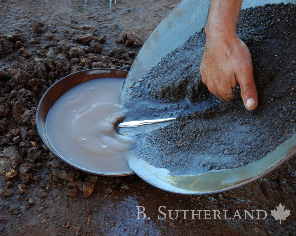 Quicksilver. Despite the health hazard, mercury is still used in the recovery of fine gold. Here excess mercury in a pan is poured into a submerged cup for later use.