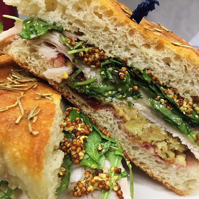 Just a little pregame action. The Thanksgiving Appetizer. All your favorite fixing in one sandwich.  There's oven roasted turkey, cranberry sauce,  stuffing, gravy, onions, dijon mustard and arugula on warm rosemary focaccia.  Gobble, gobble ya'll!
