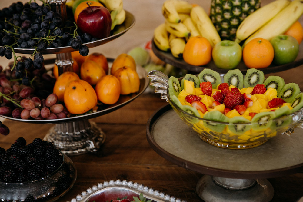 Wedding fruit table with persimmons and blackberries