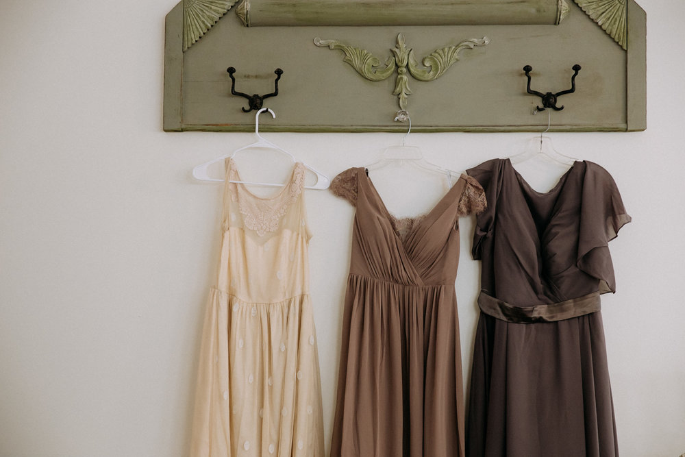 Mismatched bridesmaid's dresses hanging