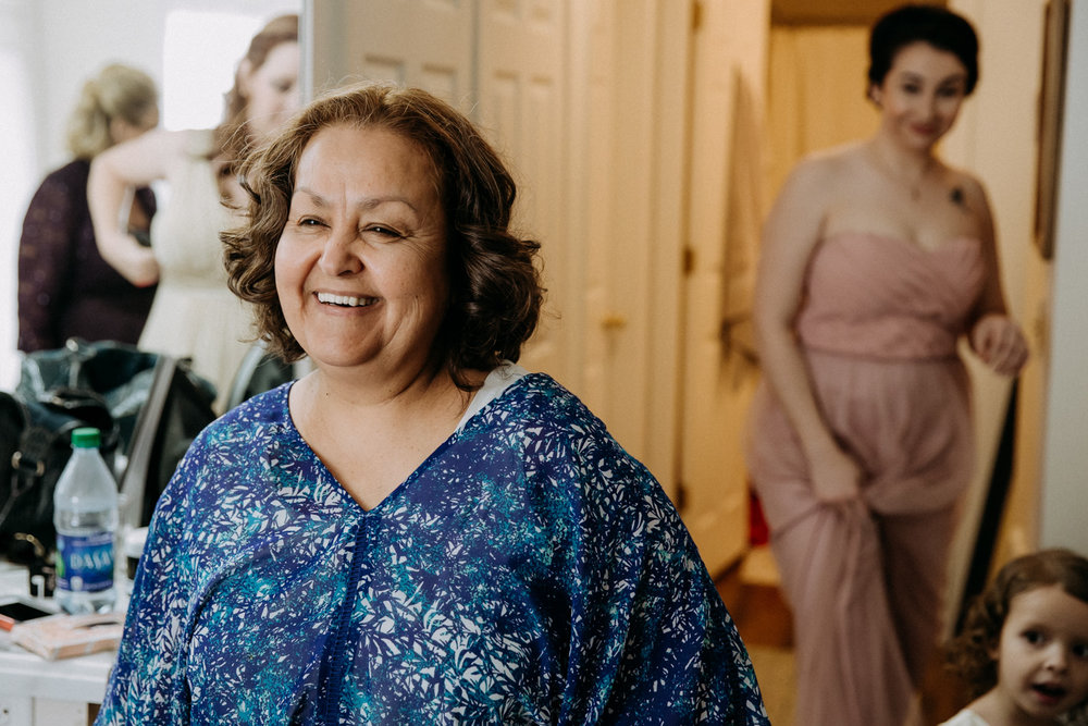 Mother-of-the-groom seeing the bride in her dress for the first time