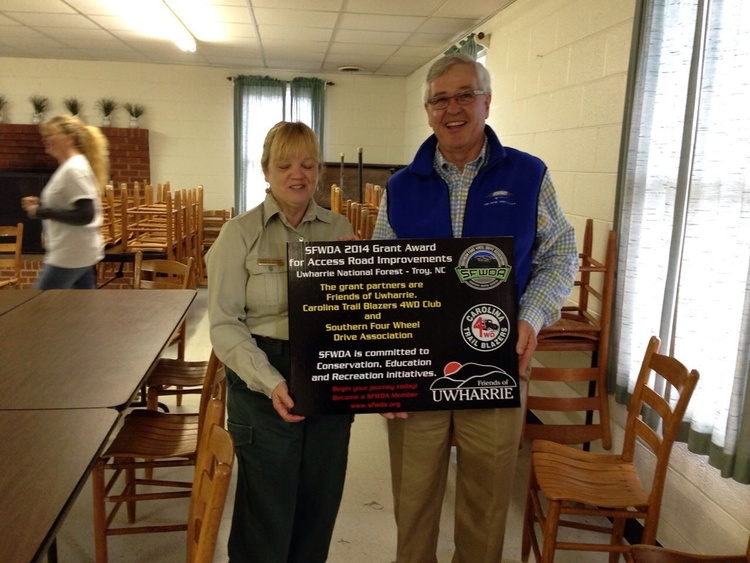 Uwharrie National Forest Ranger Deborah Walker with new SFWDA Project Signage