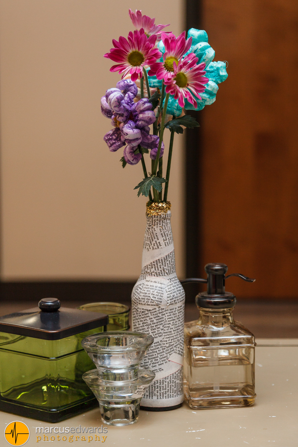 Now I want you to pay attention to this one. This is just an example of how creative Janie is. The bottle is wrapped with pages from the Bible. And the purple and green flowers are made out shipping / packing peanuts.