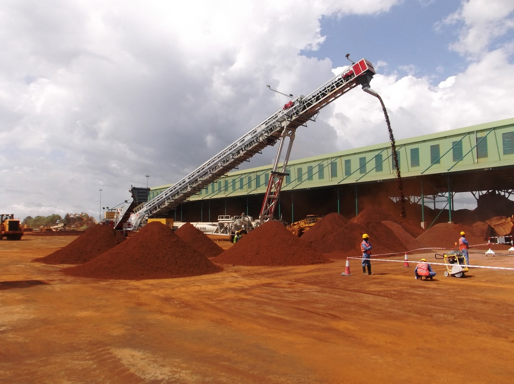 Stacking, drying, Storage and Out-Loading for Minerals, Ores and Heavy Bulk Products