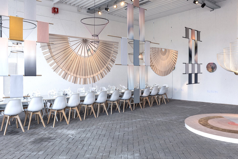 Circular Screens and Circadian Tapestries create a natural separation between the dining and exhibition areas