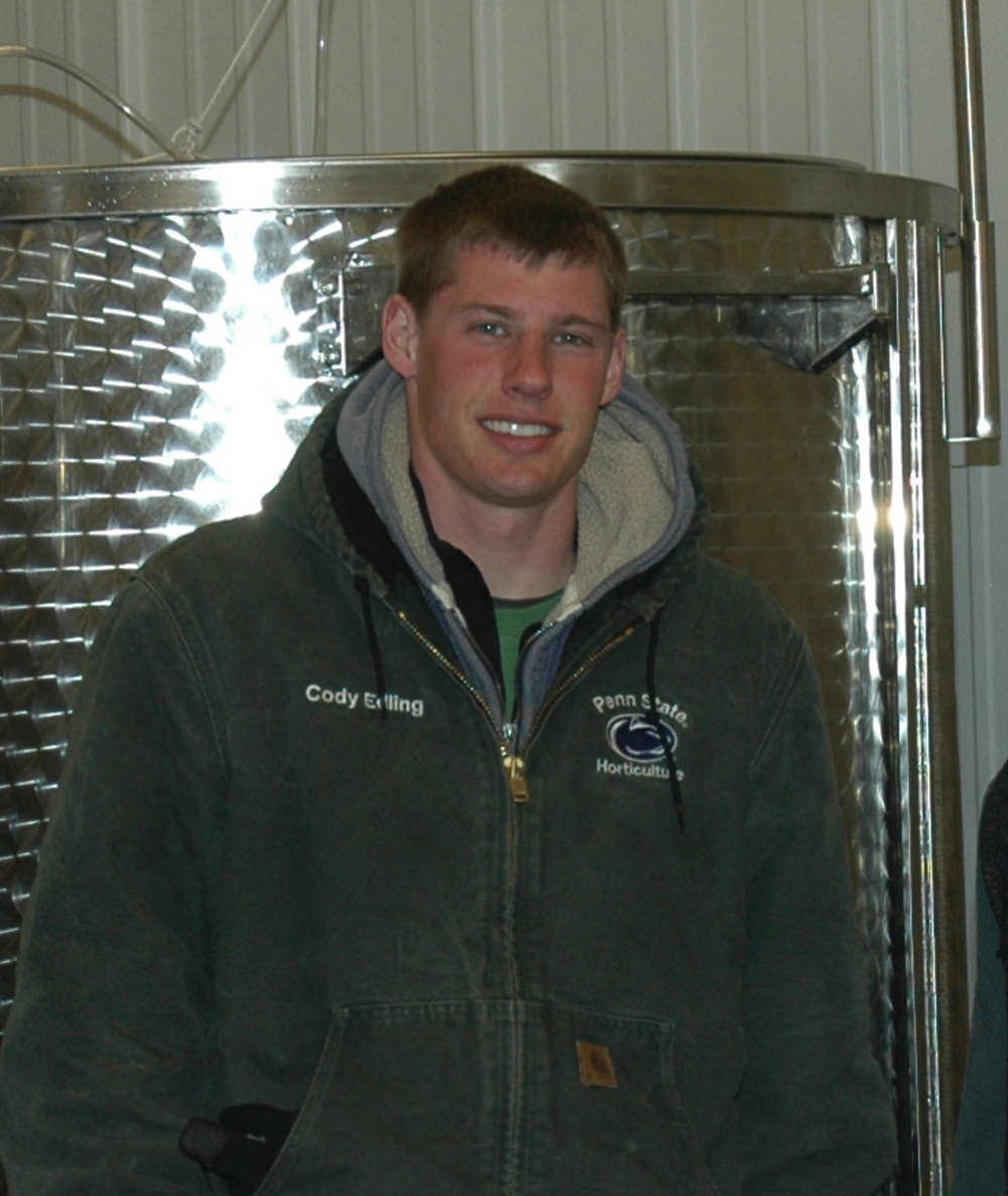 Cody washing tanks after cold stabilizing wine.