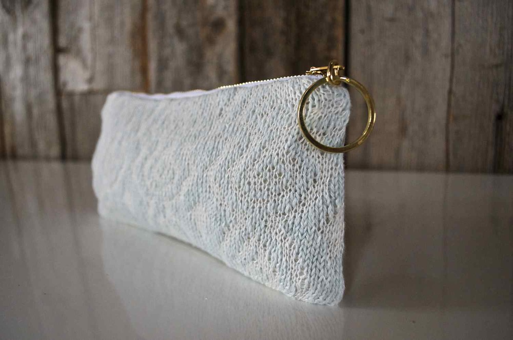 This lovely linen pouch is  available in the shop .