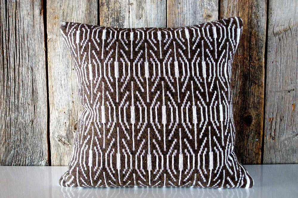 Large pillow in Walnut, knit in the MORAY design   Available now in the store.   Cheesestick and other munchables not included.