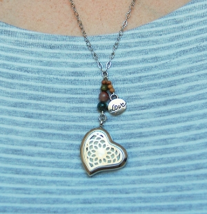This isn't just a normal necklace. It contains a diffusing pad for aromatherapy essential oils, so New Mom can wear her favorite relaxing scents around with her while she figure this whole parenting thing out!Made by Jeweled Aromatics.