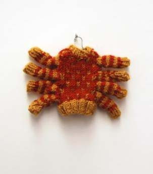 Hand knitted spider sweater, by Jen Liu