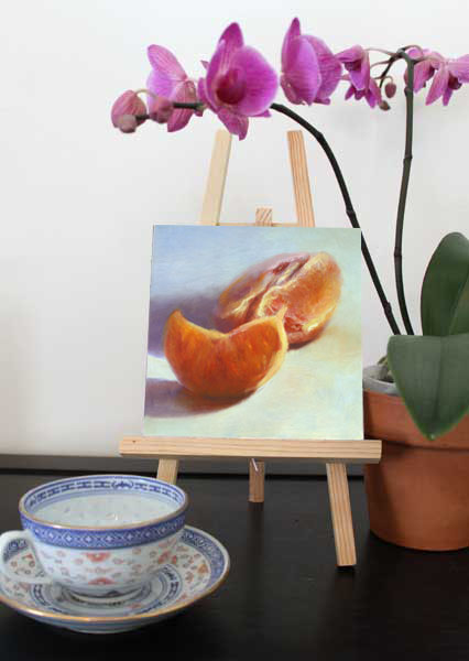 small oil painting of pink grapefruit segment