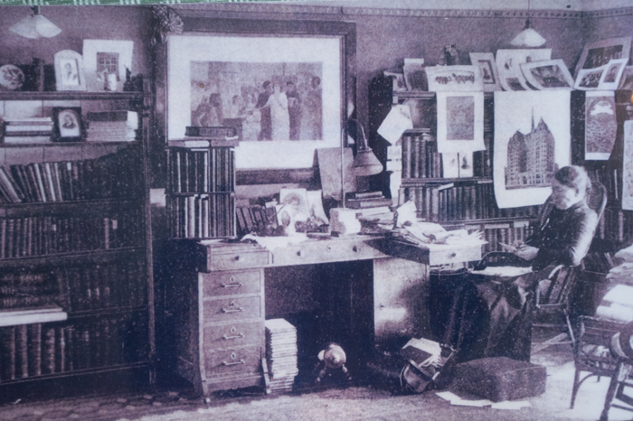 Historic image of Willard at work in her office.