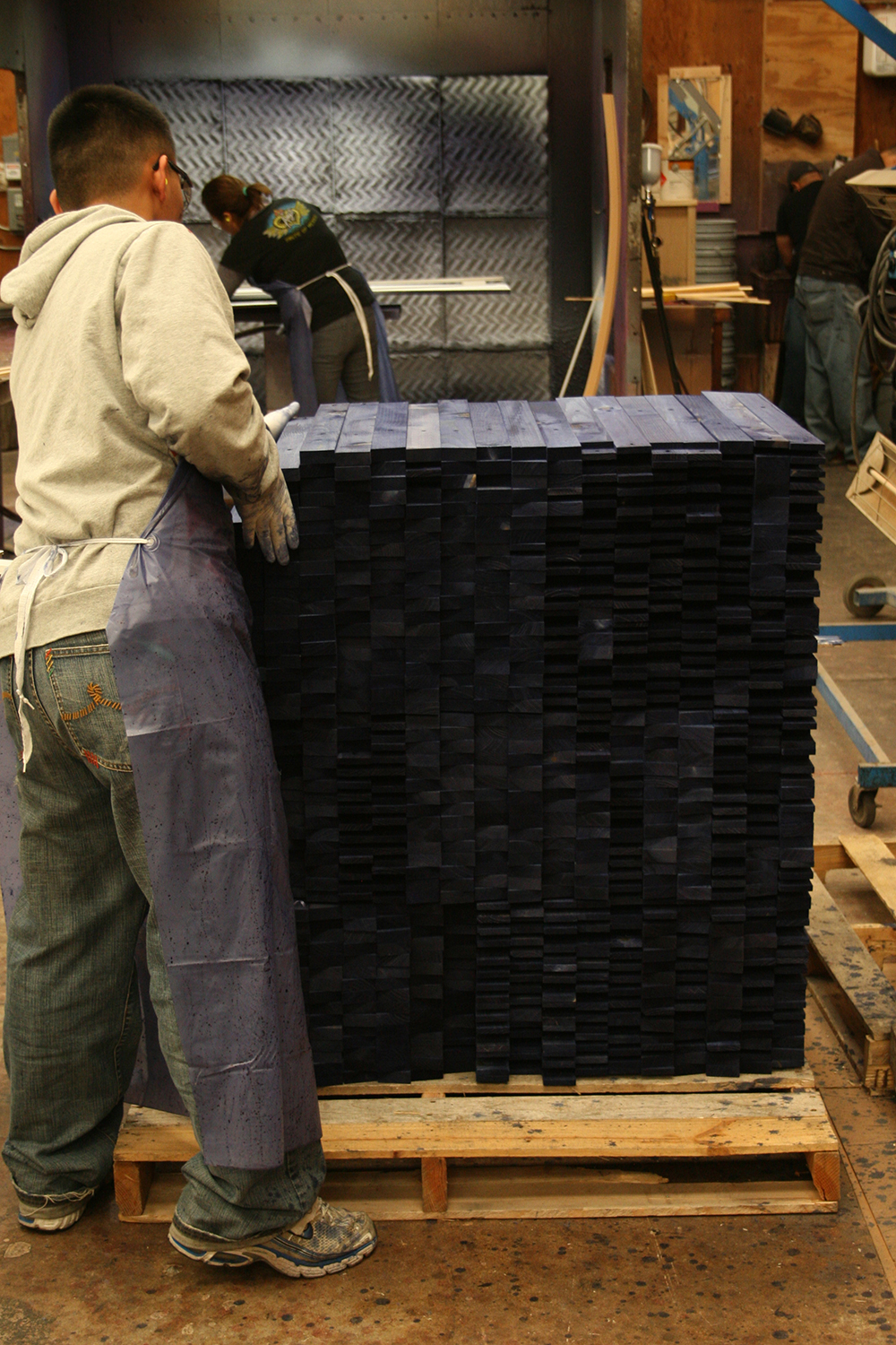 In our finishing department, these components are stained blue, dried and stacked to move on to assembly.