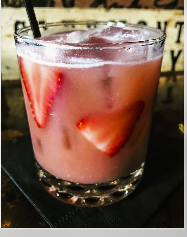 The Jack of Hearts $6 White rum, strawberry banana syrup, coconut cream, grenadine, lime