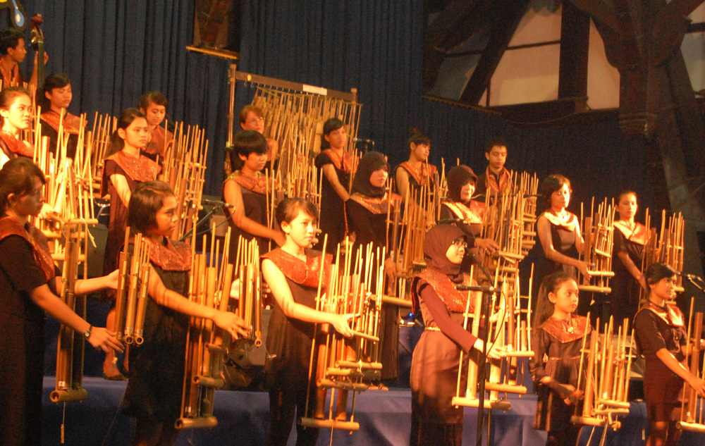 November 2011: Students playing angklungs as they compete at the Festival Paduan Angklung XIII in Bandung, indoniesia
