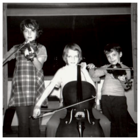 Dawn with violin (left), sister Michelle with cello (middle) and brother Jeffrey with violin (right)