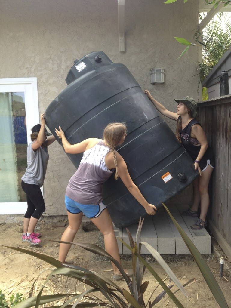 Teamwork makes installing this 500 gallon tank easy!