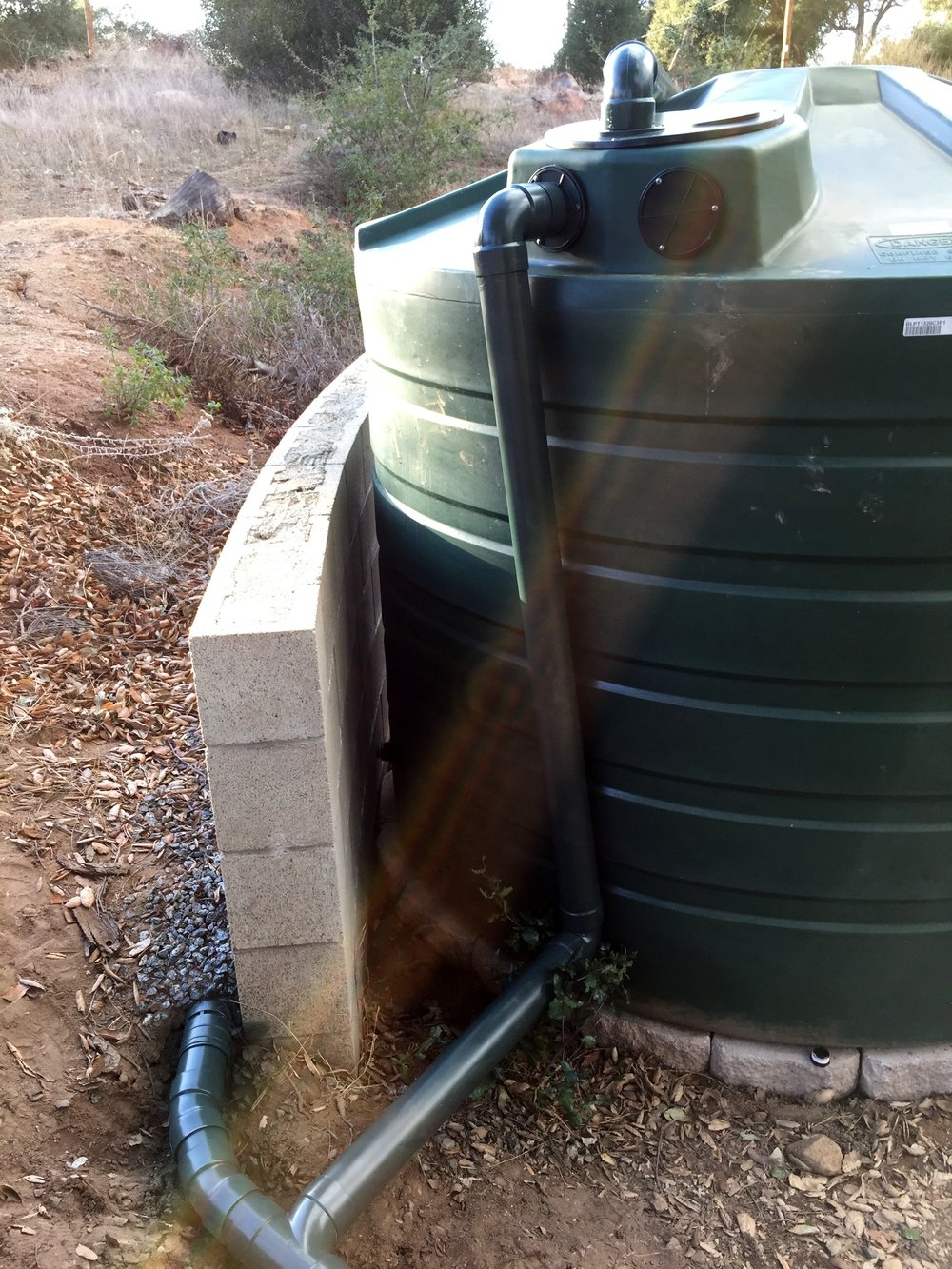 We combined the overflow from the rainwater tank with this wall drain and directed both to our raingarden