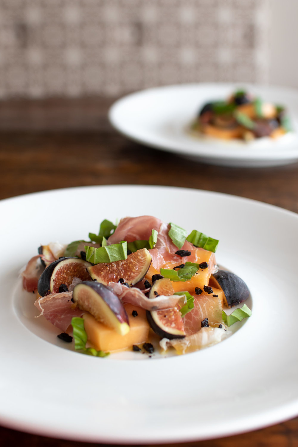 Figs & Melon with Prosciutto, Dried Black Olive & Basil // photo by Stephanie Cornell