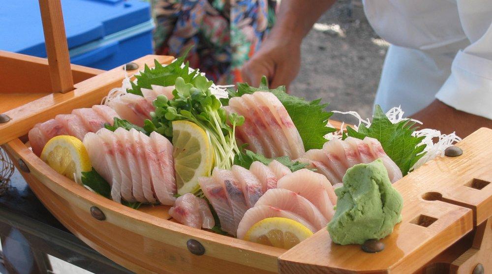 Kona Kampachi sashimi boat.jpg