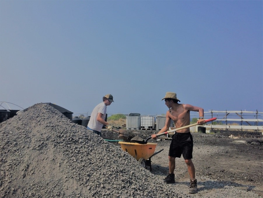 C.J. and Travis helping spread 20 tons of gravel for tank platforms.