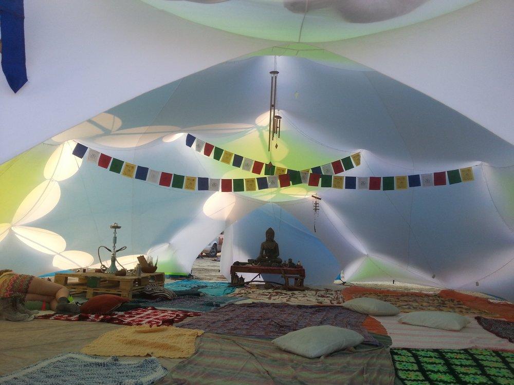 Tea House Burning Man, Black Rock City, NV August 2014 Desert Kit Frame: Lodge Shade Stars: Royal Blue, Neon Green Tent: White, flap door Retail Price: $4000