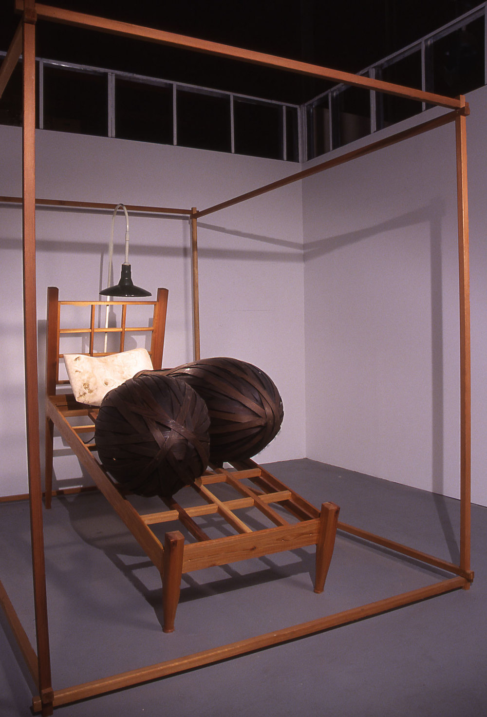 """Sleeping Double in a Single Bed"", wood sculpture 8' h x 7' w x 8' d ; ebonized Cedar, carved Poplar, electric light; © Tom Gormally"
