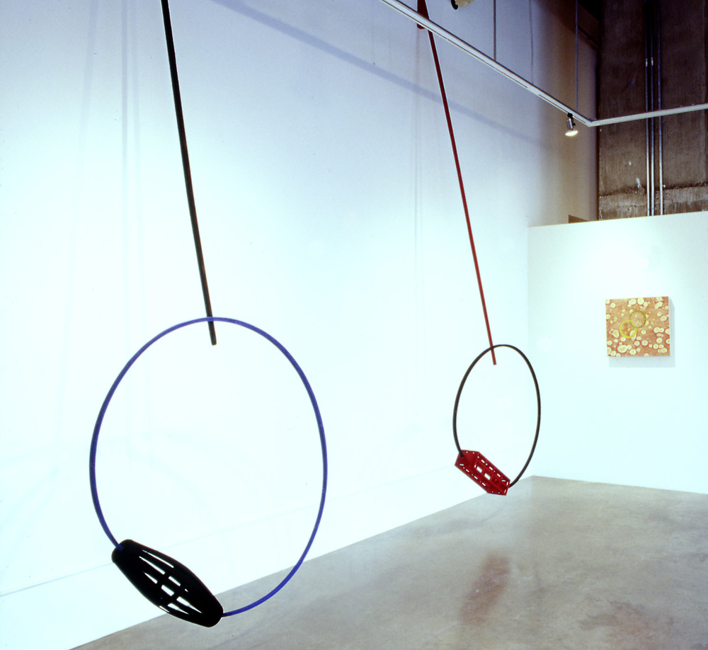"""Portals I & II, wood sculpture, 12' h x 4' w x 3' d each; flocked oak and pine; installation view, @ Tom Gormally"