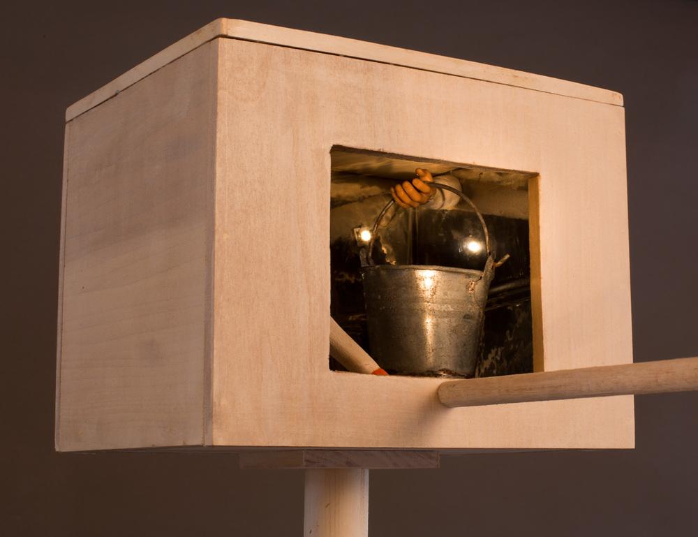 """Bucket Brigade"" (detail), 64"" h x 7"" w x 42"" d, wood, mylar, solar collector and light bulb, metal, found object; ©Tom Gormally 2014"